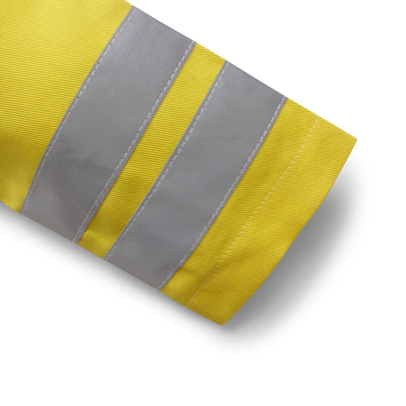 Up close detail of the cuff on a children's paramedic uniform showing the 2 hi vis stipes on the sleeve, the rolled cuff hem and the detail in the yellow cotton twill