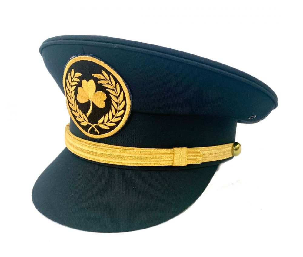 A navy peaked cap with gold bank and gold shamrock embroidered emblem- childrens pilot cap